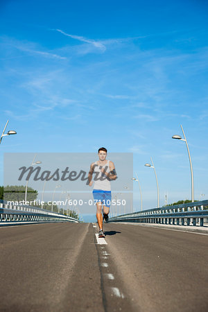 Young Man Running, Worms, Rhineland-Palatinate, Germany Stock Photo - Premium Royalty-Free, Image code: 600-07110550