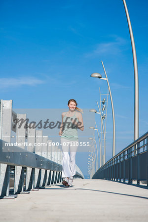 Young Woman Running, Worms, Rhineland-Palatinate, Germany Stock Photo - Premium Royalty-Free, Image code: 600-07110555