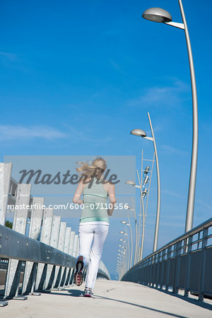 Young Woman Running, Worms, Rhineland-Palatinate, Germany Stock Photo - Premium Royalty-Free, Image code: 600-07110556