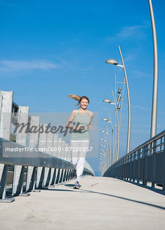 Young Woman Running, Worms, Rhineland-Palatinate, Germany Stock Photo - Premium Royalty-Free, Image code: 600-07110557