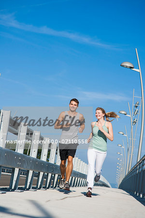 Young Couple Running, Worms, Rhineland-Palatinate, Germany Stock Photo - Premium Royalty-Free, Image code: 600-07110558