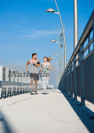 Young Couple Running, Worms, Rhineland-Palatinate, Germany Stock Photo - Premium Royalty-Free, Image code: 600-07110559
