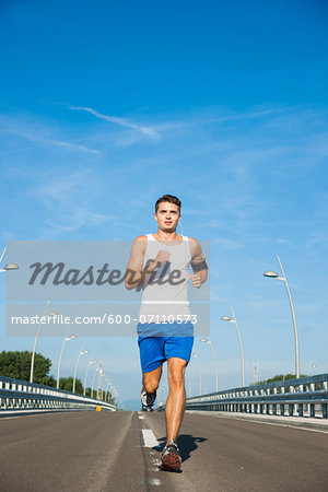 Young Man Running, Worms, Rhineland-Palatinate, Germany Stock Photo - Premium Royalty-Free, Image code: 600-07110573