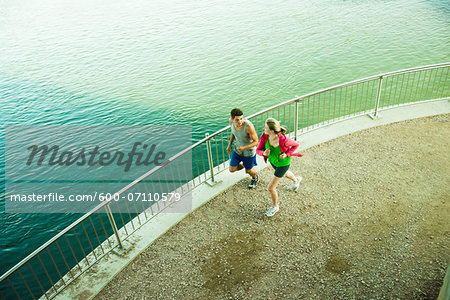 Young Couple Running by Water, Worms, Rhineland-Palatinate, Germany Stock Photo - Premium Royalty-Free, Image code: 600-07110579