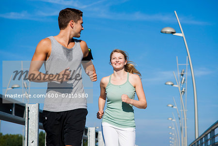 Young Couple Running, Worms, Rhineland-Palatinate, Germany Stock Photo - Premium Royalty-Free, Image code: 600-07110580