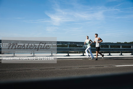 Young Couple Running, Worms, Rhineland-Palatinate, Germany Stock Photo - Premium Royalty-Free, Image code: 600-07110584