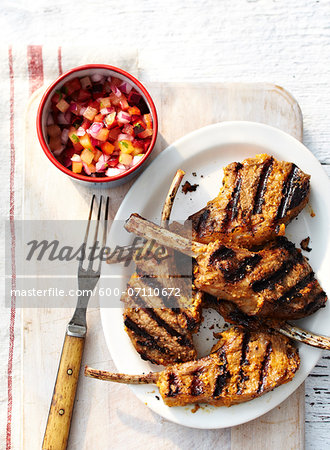 Overhead View of BBQ Lamb Chops with Salsa, Studio Shot Stock Photo - Premium Royalty-Free, Image code: 600-07110672