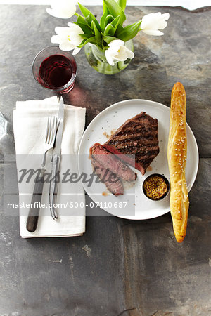 Overhead View of Steak with Spicy Mustard and Breadstick, Studio Shot Stock Photo - Premium Royalty-Free, Image code: 600-07110687