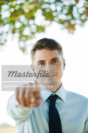 Portrait of Businessman Pointing at Camera, Mannheim, Baden-Wurttemberg, Germany Stock Photo - Premium Royalty-Free, Image code: 600-07110832