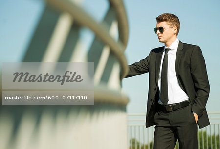Portrait of businessman standing by railing and looking at view, Germany Stock Photo - Premium Royalty-Free, Image code: 600-07117110