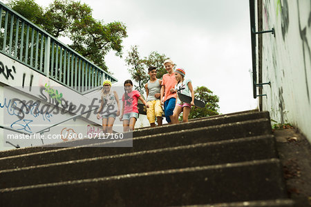 Group of children walking down stairs outdoors, Germany Stock Photo - Premium Royalty-Free, Image code: 600-07117160
