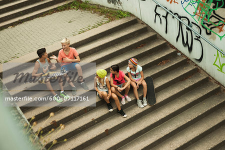 Overhead view of group of children sitting on stairs outdoors, Germany Stock Photo - Premium Royalty-Free, Image code: 600-07117161