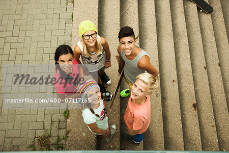 Group of children standing outdoors on cement staris, looking up at camera, Germany Stock Photo - Premium Royalty-Free, Image code: 600-07117165