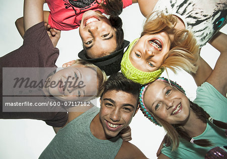 Group of children in circle, smiling and looking down at camera, Germany Stock Photo - Premium Royalty-Free, Image code: 600-07117182