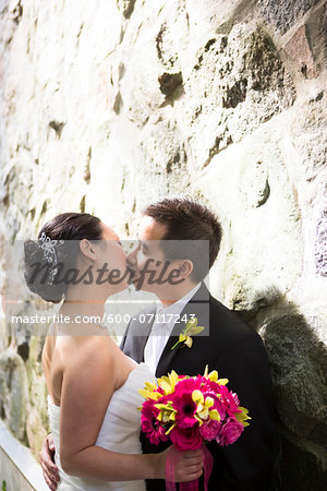 Portrait of Married Couple Kissing Outdoors, Toronto, Ontario, Canada Stock Photo - Premium Royalty-Free, Image code: 600-07117243