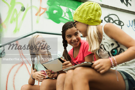 Girls Sitting on Steps with Tablet Computers, Mannheim, Baden-Wurttemberg, Germany Stock Photo - Premium Royalty-Free, Image code: 600-07117285