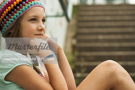 Close-up of Girl Outdoors, Mannheim, Baden-Wurttemberg, Germany Stock Photo - Premium Royalty-Free, Image code: 600-07117289