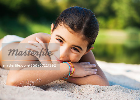 Portrait of Girl at Beach, Lampertheim, Hesse, Germany Stock Photo - Premium Royalty-Free, Image code: 600-07117292