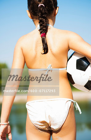 Back View of Girl with Soccer Ball, Lampertheim, Hesse, Germany Stock Photo - Premium Royalty-Free, Image code: 600-07117293