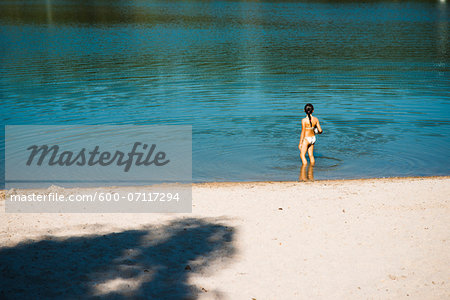 Girl in Lake, Lampertheim, Hesse, Germany Stock Photo - Premium Royalty-Free, Image code: 600-07117294