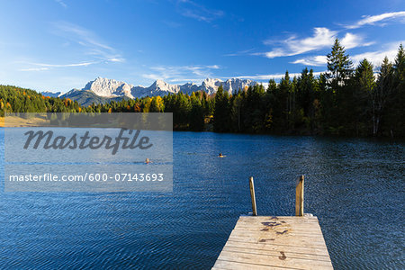 Wooden Dock at Wagenbruchsee with Karwendel Mountains in Autumn, Bavaria, Germany Stock Photo - Premium Royalty-Free, Image code: 600-07143693
