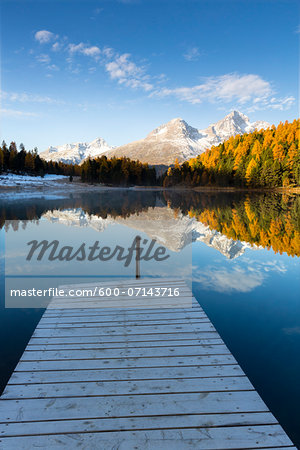Jetty at Lake Staz with Larch Trees and Snow Covered Piz Nair Reflected in it in Autumn, Canton of Graubunden, Switzerland Stock Photo - Premium Royalty-Free, Image code: 600-07143716