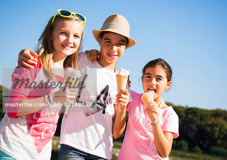 Girls eating Ice Cream Cones, Lampertheim, Hesse, Germany Stock Photo - Premium Royalty-Free, Image code: 600-07148087