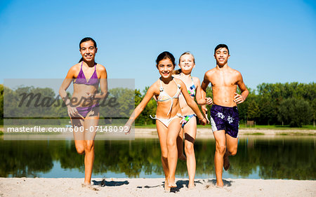 Kids Running on Beach by Lake, Lampertheim, Hesse, Germany Stock Photo - Premium Royalty-Free, Image code: 600-07148092