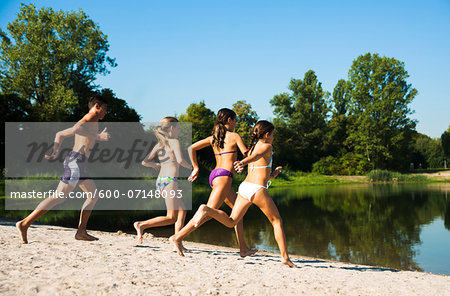 Kids Running on Beach by Lake, Lampertheim, Hesse, Germany Stock Photo - Premium Royalty-Free, Image code: 600-07148093
