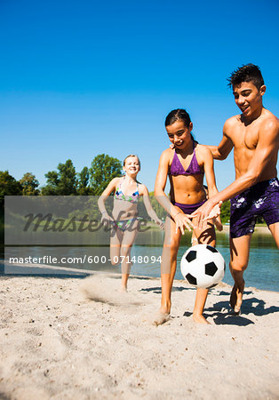 Kids Playing Soccer on Beach by Lake, Lampertheim, Hesse, Germany Stock Photo - Premium Royalty-Free, Image code: 600-07148094