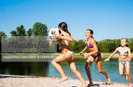 Kids Playing Soccer on Beach by Lake, Lampertheim, Hesse, Germany Stock Photo - Premium Royalty-Free, Image code: 600-07148095