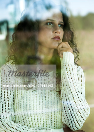 Close-up portrait of teenage girl looking out window, Germany Stock Photo - Premium Royalty-Free, Image code: 600-07148143