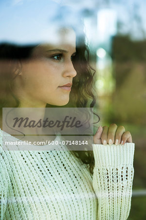 Close-up portrait of teenage girl looking out window, Germany Stock Photo - Premium Royalty-Free, Image code: 600-07148144