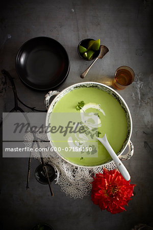 Cilantro soup in bowl with red flower, Mexican Fiesta, studio shot Stock Photo - Premium Royalty-Free, Image code: 600-07156150