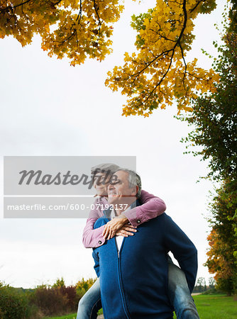 Man giving Woman Piggyback Ride, Mannheim, Baden-Wurttemberg, Germany Stock Photo - Premium Royalty-Free, Image code: 600-07192137