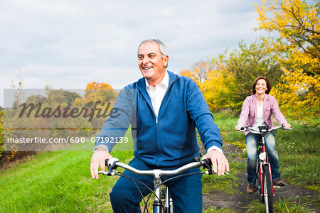 Couple Riding Bicycles in Autumn, Mannheim, Baden-Wurttemberg, Germany Stock Photo - Premium Royalty-Free, Image code: 600-07192139