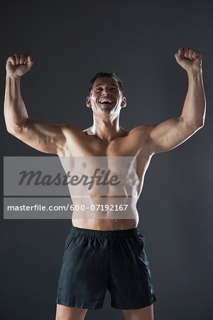 Portrait of Fit Man Cheering, Studio Shot Stock Photo - Premium Royalty-Free, Image code: 600-07192167