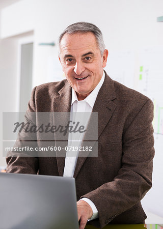 Businessman in Office, Mannheim, Baden-Wurttemberg, Germany Stock Photo - Premium Royalty-Free, Image code: 600-07192182