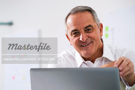 Businessman in Office, Mannheim, Baden-Wurttemberg, Germany Stock Photo - Premium Royalty-Free, Image code: 600-07192184
