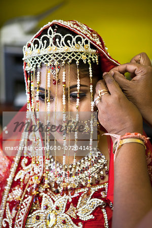 Hindu Woman getting ready for Wedding, Toronto, Ontario, Canada Stock Photo - Premium Royalty-Free, Image code: 600-07204145