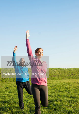 Man and Woman Exercising Outdoors, Baden-Wurttemberg, Germany Stock Photo - Premium Royalty-Free, Image code: 600-07236618