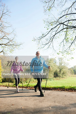 Couple Nordic Walking Outdoors, Mannheim, Baden-Wurttemberg, Germany Stock Photo - Premium Royalty-Free, Image code: 600-07237883