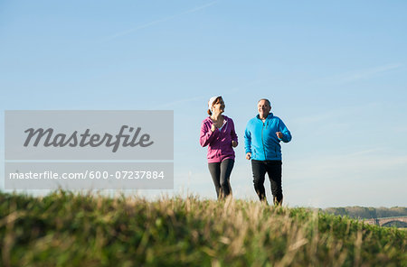 Couple Jogging Outdoors, Mannheim, Baden-Wurttemberg, Germany Stock Photo - Premium Royalty-Free, Image code: 600-07237884