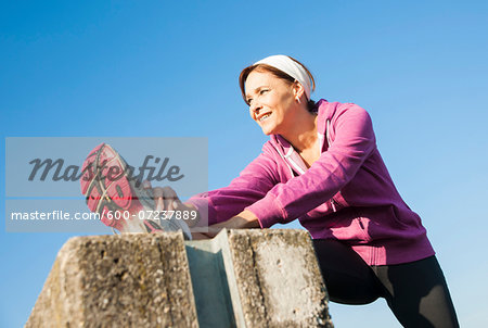 Mature Woman Stretching Outdoors, Mannheim, Baden-Wurttemberg, Germany Stock Photo - Premium Royalty-Free, Image code: 600-07237889