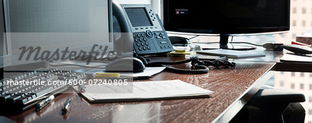 Desk in office with computer monitors, phone and paperwork, Canada Stock Photo - Premium Royalty-Free, Image code: 600-07240805