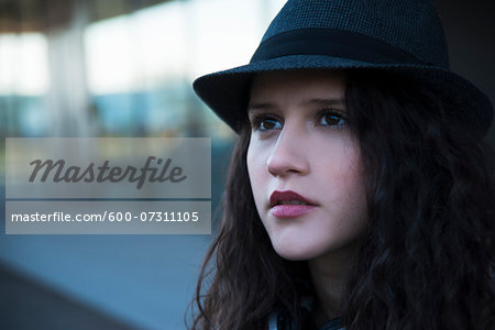 Close-up portrait of teenage girl outdoors, wearing fedora, Germany Stock Photo - Premium Royalty-Free, Image code: 600-07311105