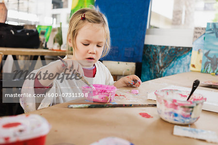 Portrait of Girl Painting in Classroom Stock Photo - Premium Royalty-Free, Image code: 600-07311308