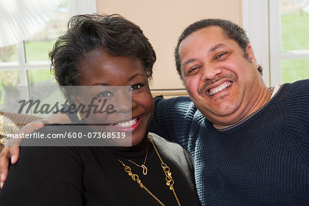 Portrait of Happy Mature Couple at Home Stock Photo - Premium Royalty-Free, Image code: 600-07368539