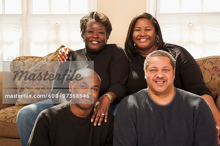 Portrait of Adult Family on Sofa Stock Photo - Premium Royalty-Free, Image code: 600-07368546