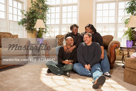 Portrait of Adult Family in Living Room Stock Photo - Premium Royalty-Free, Image code: 600-07368547